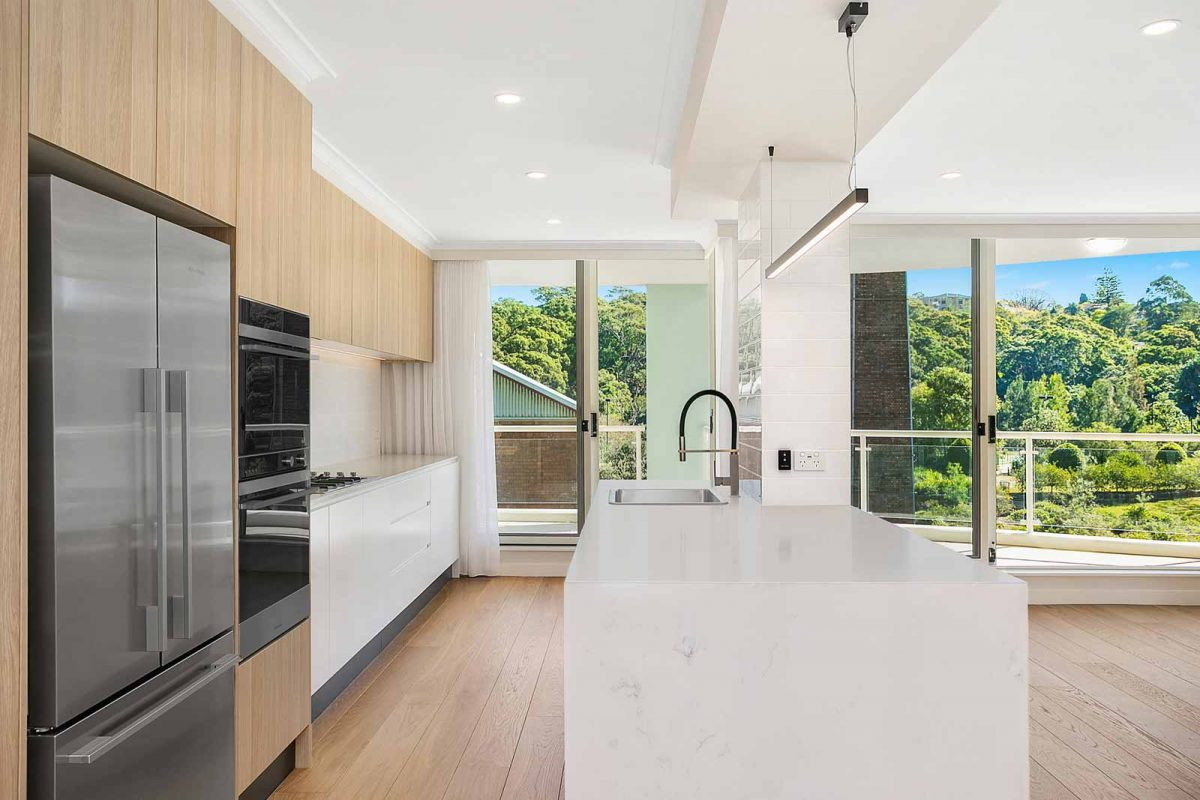 Apartment renovations Sydney Renopack smart stone cararra kitchen after photo