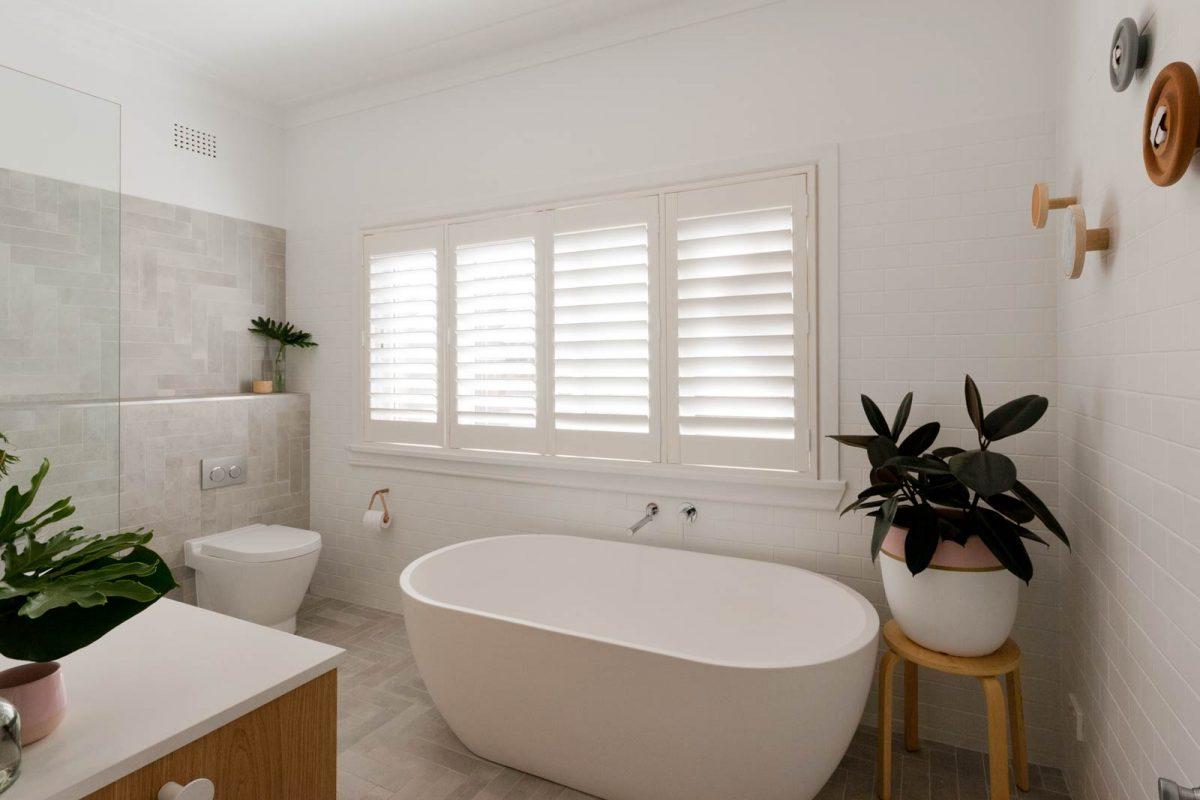 Modern bathroom renovation Sydney grey herringbone tile freestanding bath by Reno Pack Pty Ltd