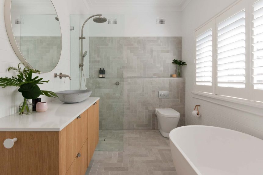 Modern bathroom renovation Sydney grey herringbone tile freestanding bath by Reno Pack Pty Ltd