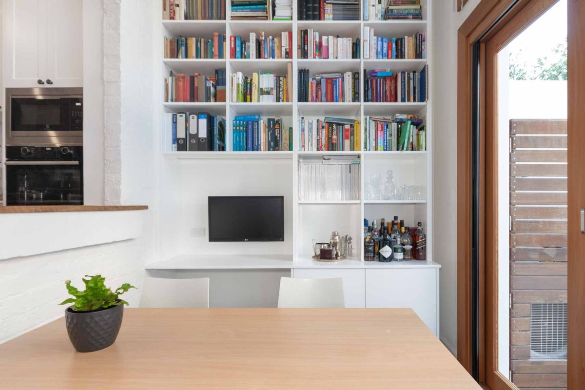 Apartment renovation in Balmain, Sydney with custom built book shelf and study desk