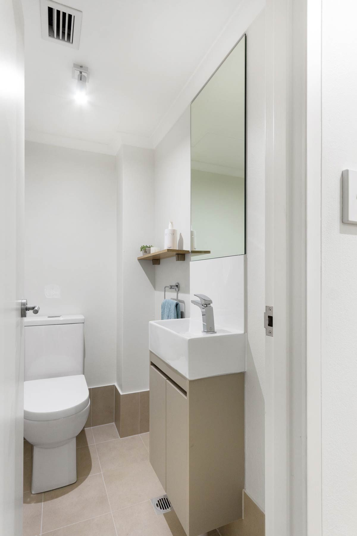 Apartment renovation bathroom by Reno Pack Sydney featuring custom made ensuite vanity
