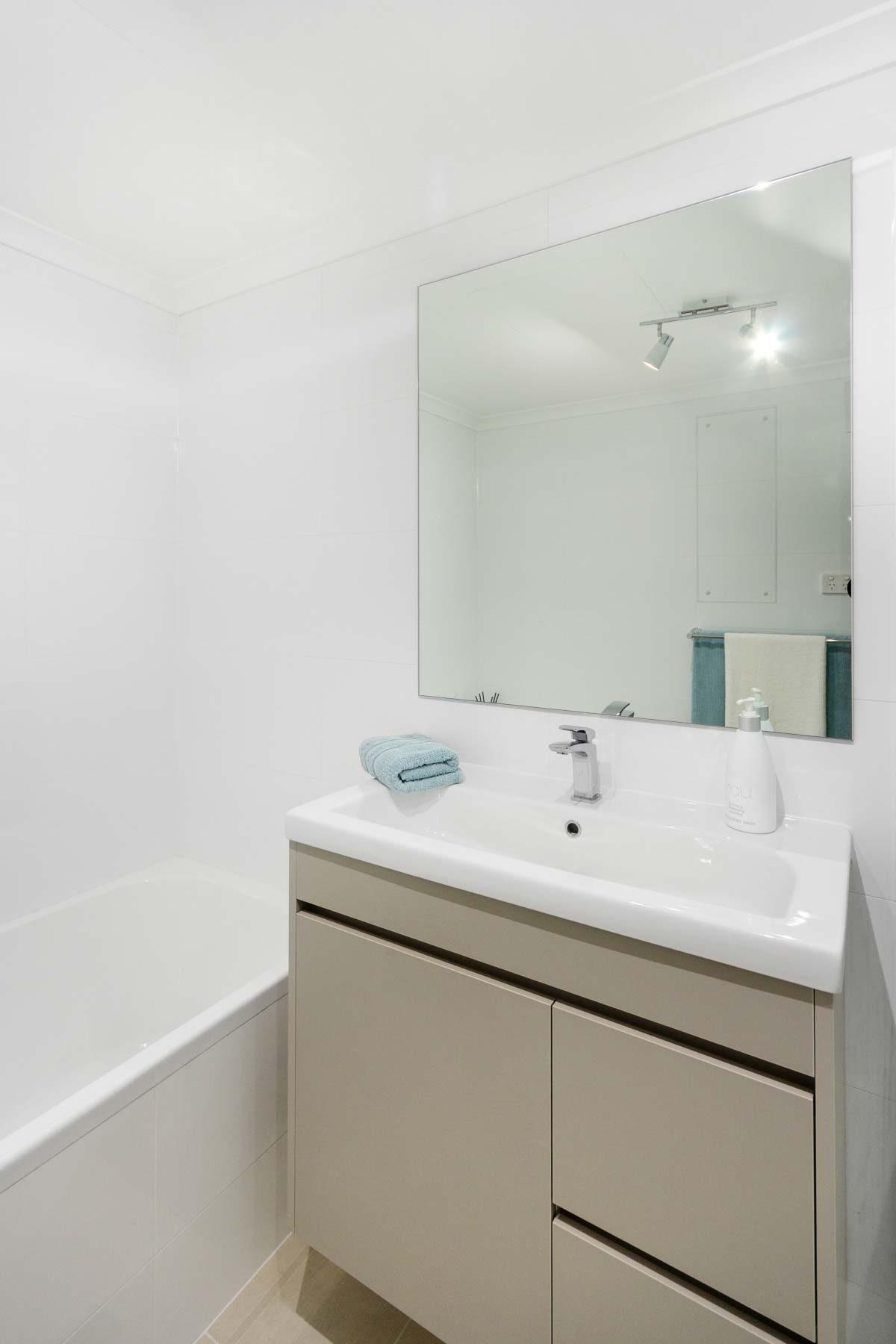 Apartment renovation bathroom by Reno Pack Sydney featuring custom made vanity