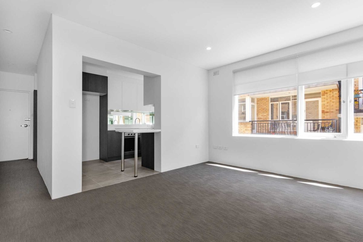 Apartment living room renovation in Summer Hill featuring new carpet, blinds & paint.